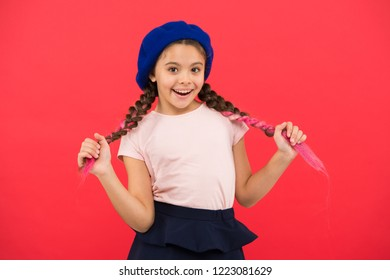 Kid little cute girl smiling face posing in hat red background. How to wear french beret. Beret style inspiration. How to wear beret like fashion girl. Fashionable beret accessory for female.