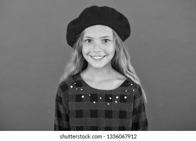 Kid little cute girl smiling face posing in hat red background. Fashionable beret accessory for female. How to wear french beret. Beret style inspiration. How to wear beret like fashion girl.