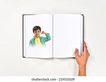 Kid making a crazy gesture printed on book