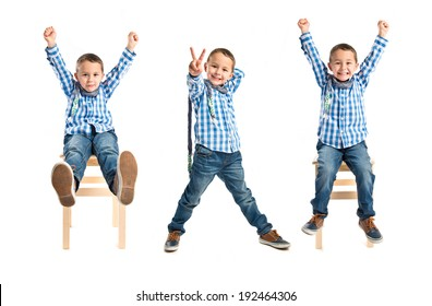 Kid making victory sign over white background