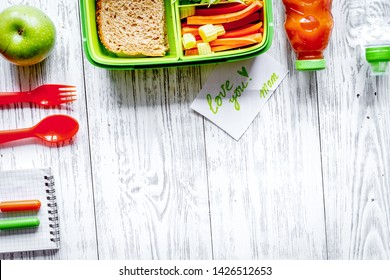 kid menu lunchbox for school top view on wooden background