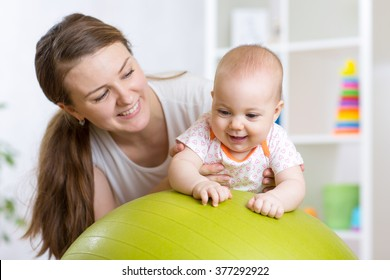 kid and mother with fitness ball