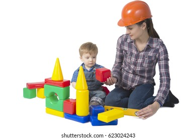 Kid and mother play with toys plastic blocks together isolated on white background.