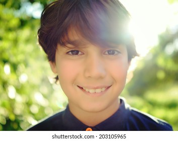 Kid in nature with lens flare in background