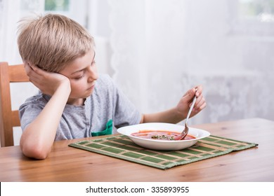 Kid with no appetite playing with food
