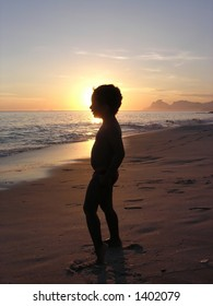Kid on the beach in silhouette