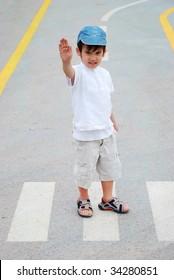 Kid on pedestrian side walk