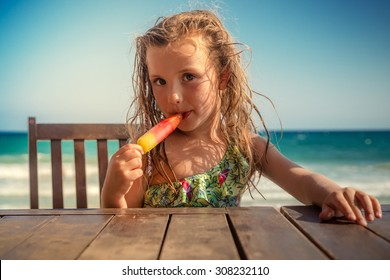 kid on table eating icecream
