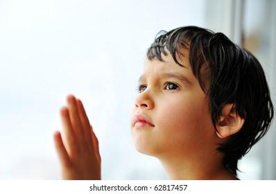 Kid on window waiting
