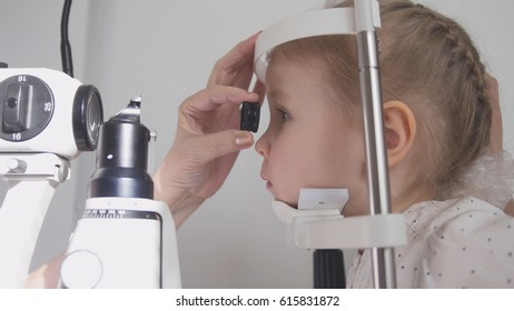 Kid ophthalmology - optometrist checking little child's vision