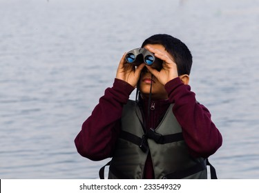 kid outdoors with binoculars
