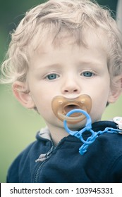 Kid with pacifier portrait.