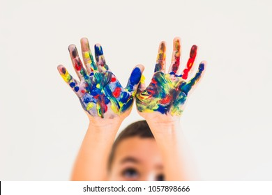 Kid painted hands against white background