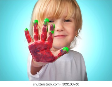 Kid with painted hands, indian, paintings.