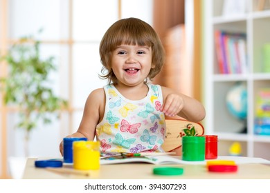 kid painting in daycare or playschool