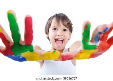 Kid painting and playing with paint colors