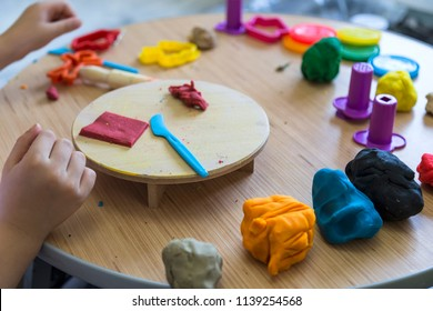 the kid play with play dough and in the preschool or nursery for education concept.