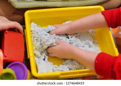 kid play kinetic sand   the child's hands into kinetic sand. childhood development