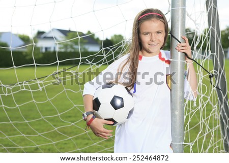 Kid play soccer on a field