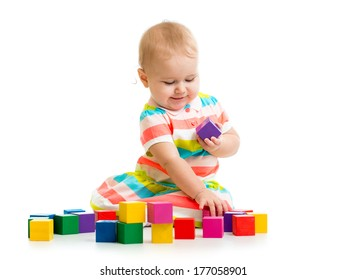 kid playing with block toys