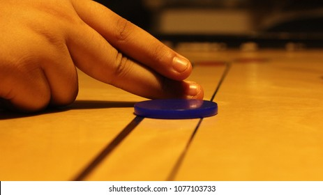 Kid Playing Carom close up