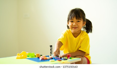 kid playing creative thinking toy for  enhance brain development