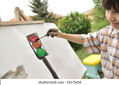 Kid playing and drawing outdoor, traffic light