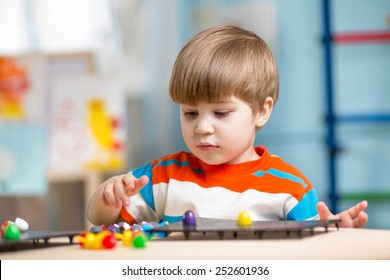 kid playing with educational toys on a table