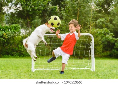Kid playing football (soccer) as goalie afraid of ball flying after header shot