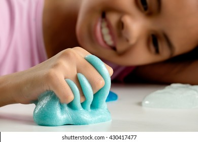 Kid Playing Hand Made Toy Called Slime