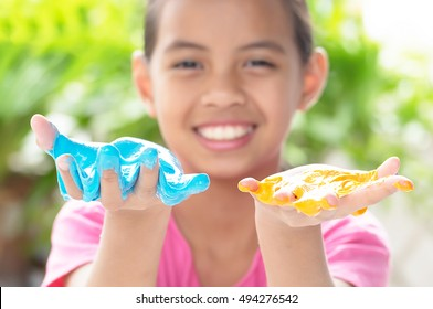 Kid Playing Hand Made Toy Called Slime, Selective focus on Slime
