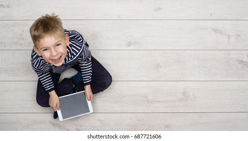 Kid playing with his tablet pc