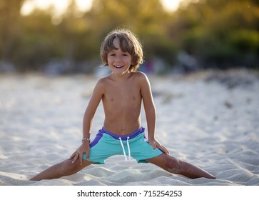 A kid is playing on the beach