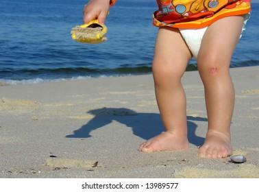 Kid playing on the beach in Niteroi, Rio de Janeiro, Brazil