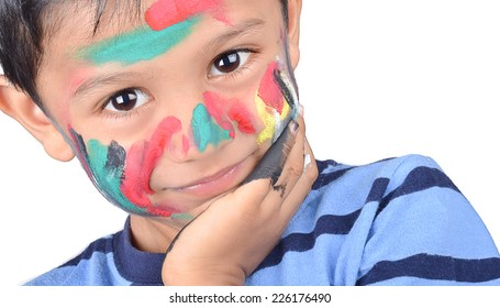 kid playing with paints