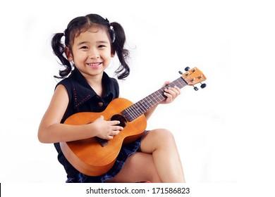 kid playing ukulele