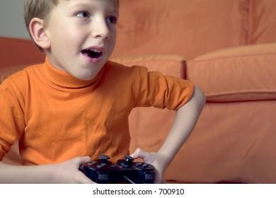 Kid playing video game, exa