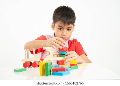 Kid playing wood block building