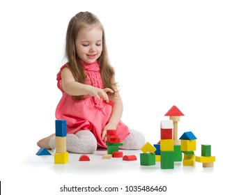 Kid playing with wooden block toys. Toddler baby girl building castle using cubes. Educational toys for preschool and kindergarten child.