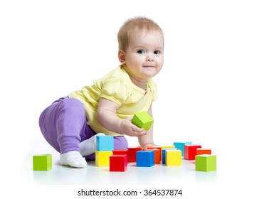 kid playing wooden toy blocks isolated