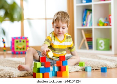 kid playing  wooden toys at home or kindergarten