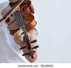 The kid plays the violin with white background