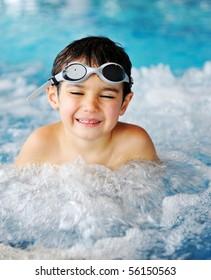 Kid in pool smiling