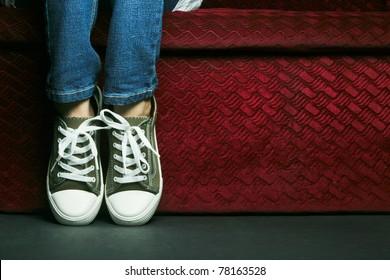A kid posing her feet.