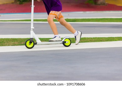 Kid practicing scooter.