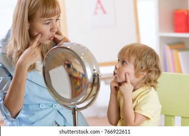 Kid preschooler boy at speech therapist office