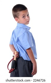 Kid in primary school with naughty look and slingshot in back pocket