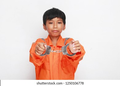 kid in prison using handcuff. children in jail with handcuff.