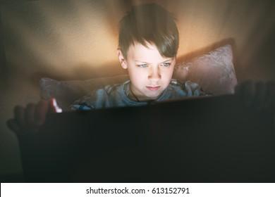 Kid reading book, light in darkness, light magic, fairy tales, childhood dreams