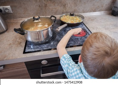 Kid risking accident with cooker in kitchen. Hazard at home. Concept of burn children